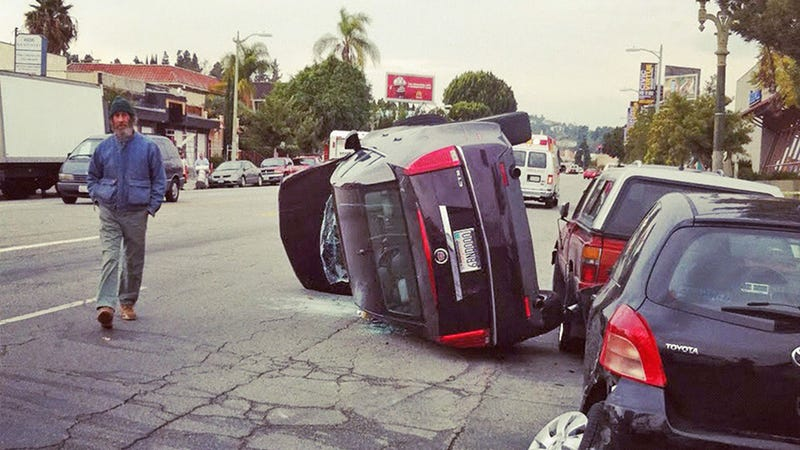 Just Another Day In L.A. As Cadillac Flips Over Yaris