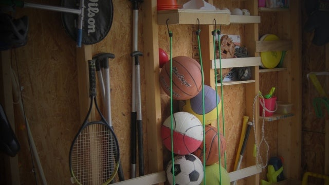 Store Sports Balls Upright with Bungee Cords
