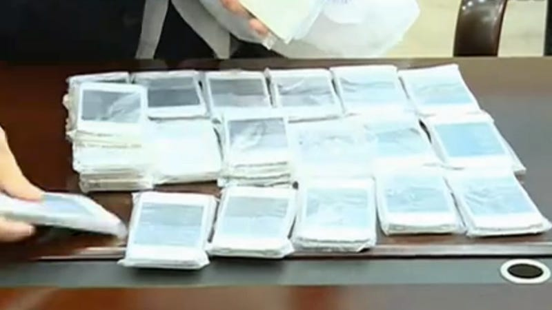 Chinese Schoolgirl Caught Smuggling a Whole Buttload of iPhones