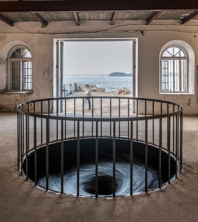 You Can See an Endless Water Vortex Beneath This Floor