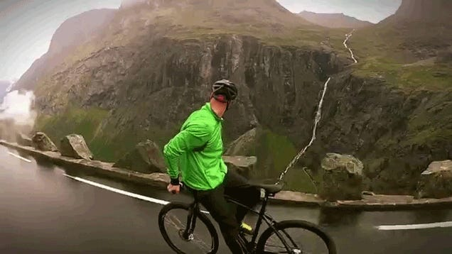 Crazy guy rides a bicycle backwards down a steep mountain