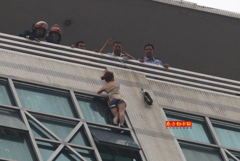 Climbing on the Side of a Building To Save a Suicidal Woman