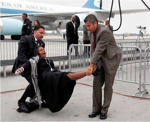 Obama Thugs Peek Up Reporter-Priestess's Cassock