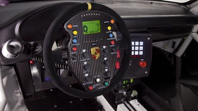 The Porsche 911 GT3 R Hybrid's wheel is the world's most insane video game controller