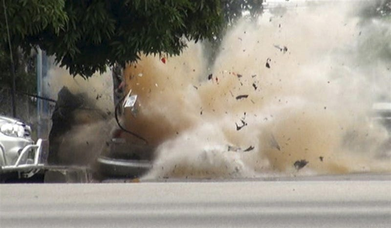 The Four Frame Horror of a Car Exploding In Front of a Bomb Squad Officer