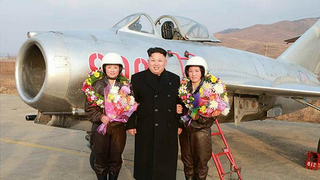 Kim Jong Un Visits Female Fighter Pilots, Picks Up Camera For Photo Op