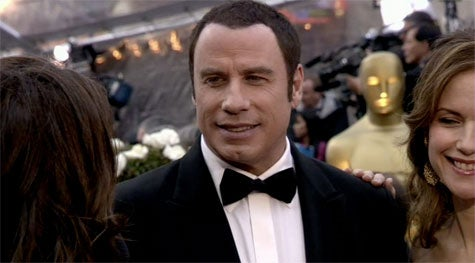 John Travolta's Hair: Clearly Came From A Can