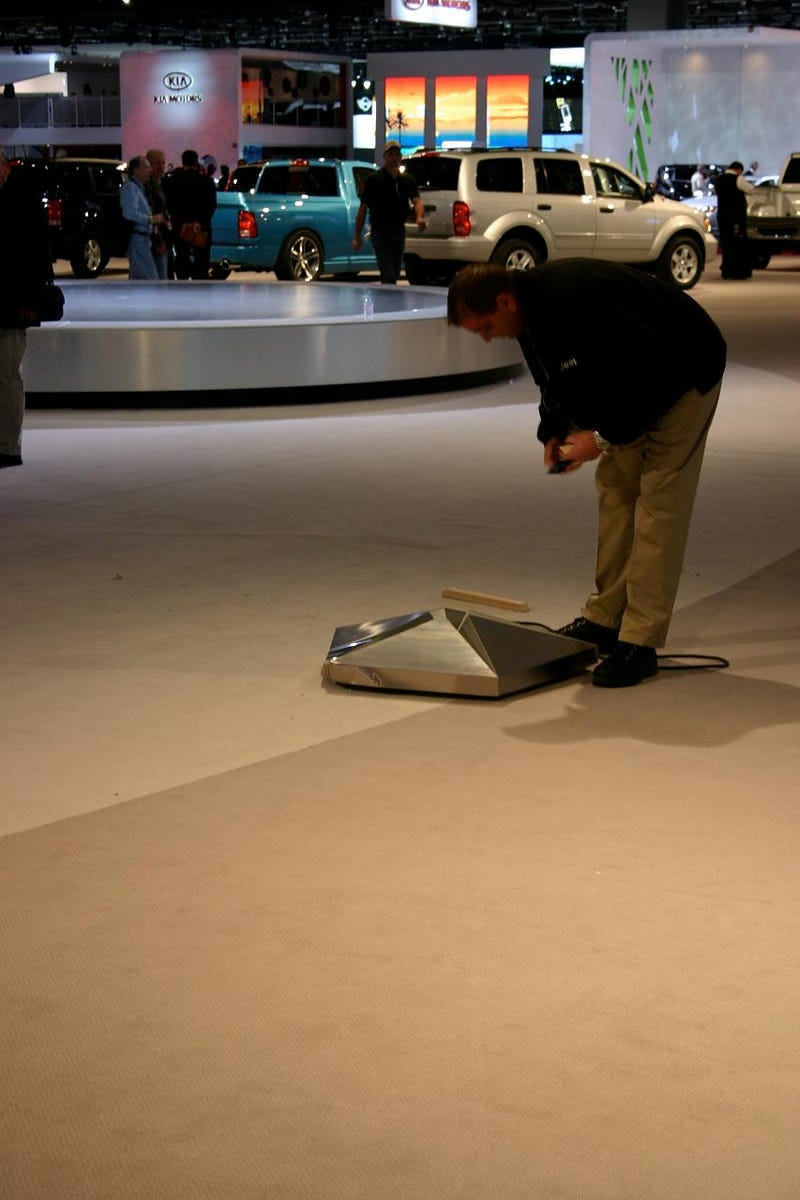 Chrysler Sign Almost Decapitates Detroit Auto Show-goer