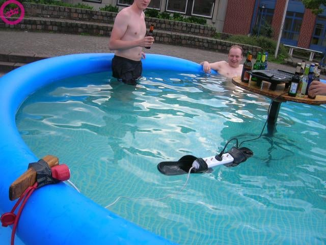 How to Win a Darwin Award: Float a Live Surge Protector in a Pool on a Couple of Flip-Flops