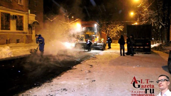 Why do Russians pour asphalt over snowed roads instead of plowing them?