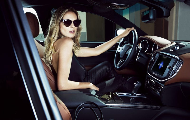 Heidi Klum Proves You Can Look Good Getting Out Of A Race Car