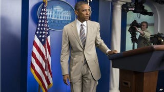 I think the president looks very dapper in a tan suit