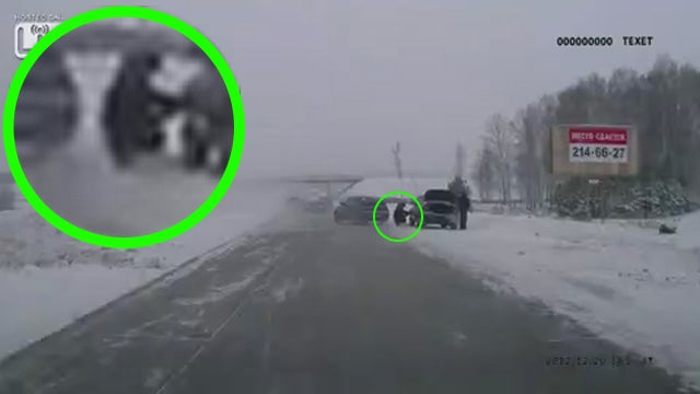 Out-Of-Control Car Misses Man Changing Tire By Slimmest Margin