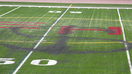 Anarchist Maniacs Burn Dollar Sign Into East Hampton High Football Field