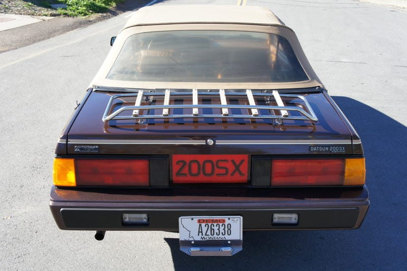 For $6,500 — top down and brown, loaded up and Datsun