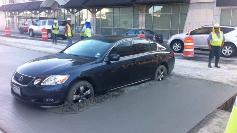 Lexus driver plows straight into fresh cement