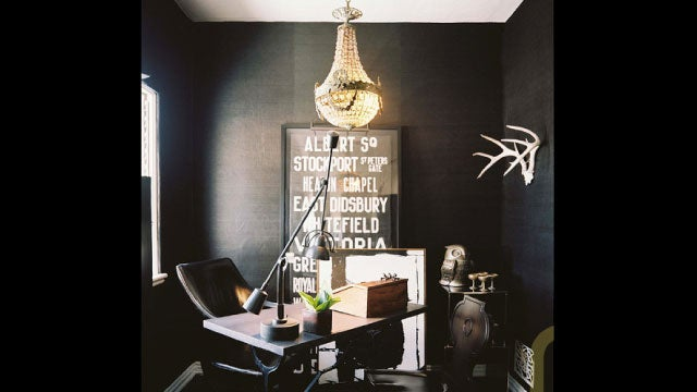 Black Walls and Vintage Finds: The Dramatic Workspace