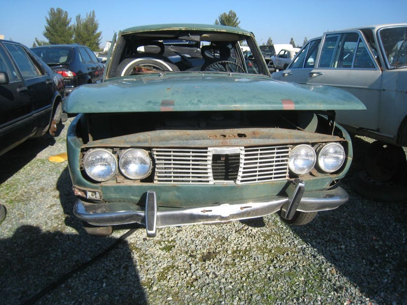 1969 Saab 99 Surrounded By Jaguars On Death Row