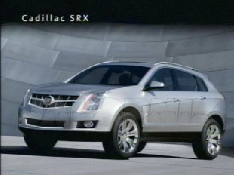 Rick Wagoner Unwraps First Shots Of Chevy Cruze, Cadillac SRX