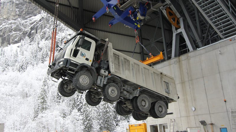 "This Is How You ""Fly"" Trucks Up a 6,500-Foot Mountain With No Roads"