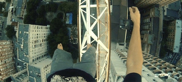 Fearless guy walks and dances barefoot on a crane in terrifying video