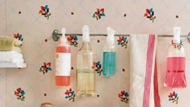 Repurpose a Towel Rod Into a Cleaning Spray Holder