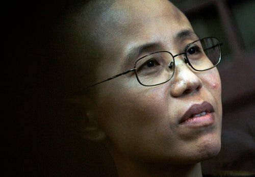 Wife of Chinese Nobel Prize Winner Placed Under House Arrest