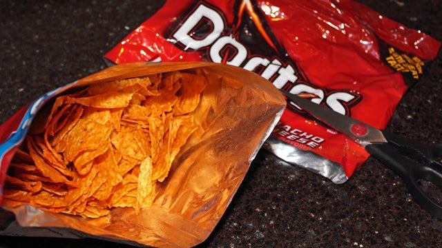 Cut Off The Tops of Chip Bags to Get to The Bottom Without a Mess