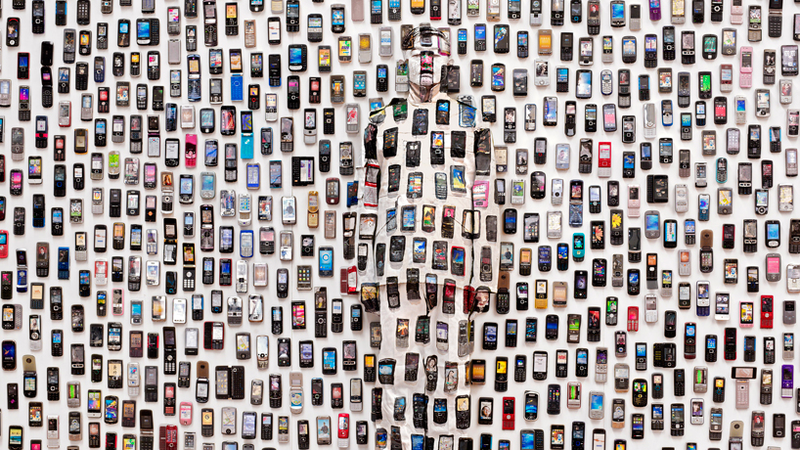 Can You Find the Man Hiding Among These Mobile Phones?