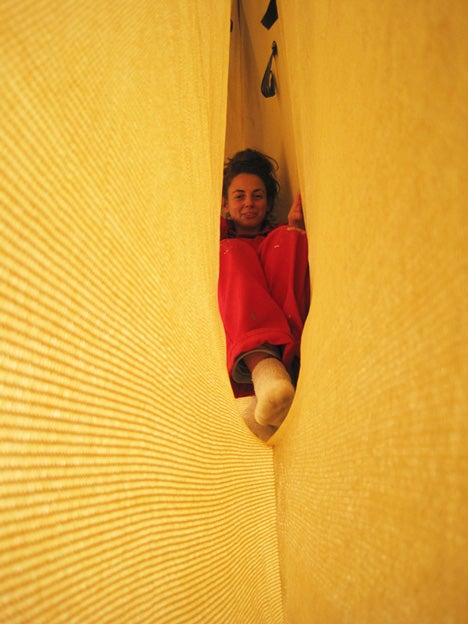 Designer creates a narrow house suspended between two sheets of fabric