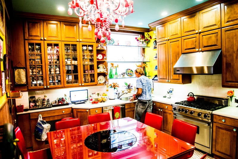 """""""The red-lacquer kitchen table seats eight and has a built-in lazy Susan."""""""