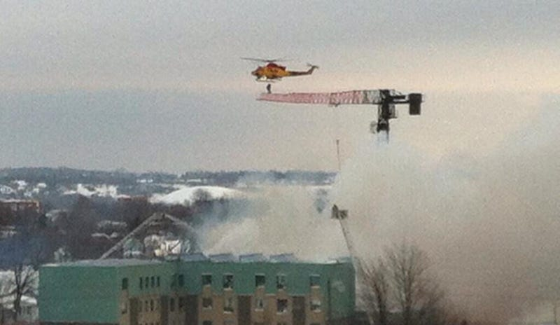 Helicopter incredibly rescues a man trapped on a crane after explosion