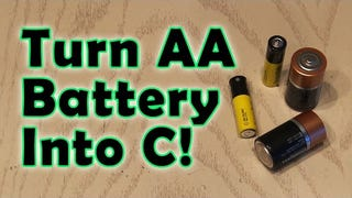 Convert AA Batteries Into C Batteries with Some Thin Cardboard Strips