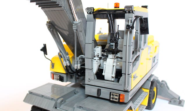 A Lego Volvo excavator so massive and detailed you can't see the studs