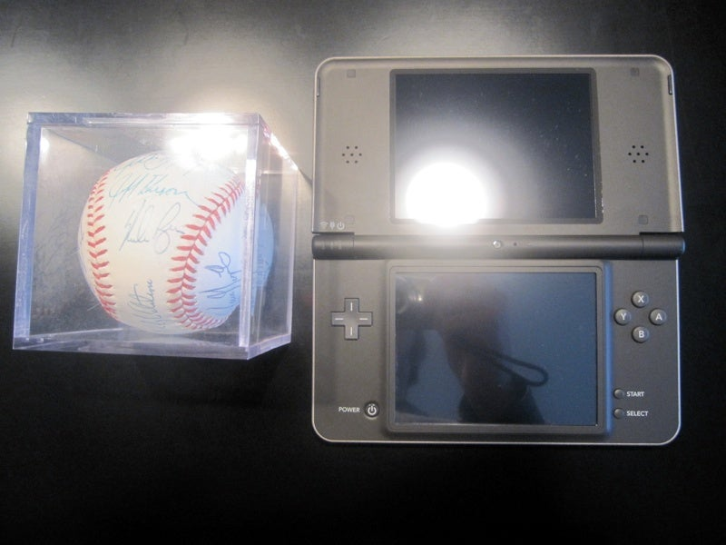 Is The DSi LL Bigger Than Uncharted 2, Nolan Ryan's Autograph, A Can of Beer?