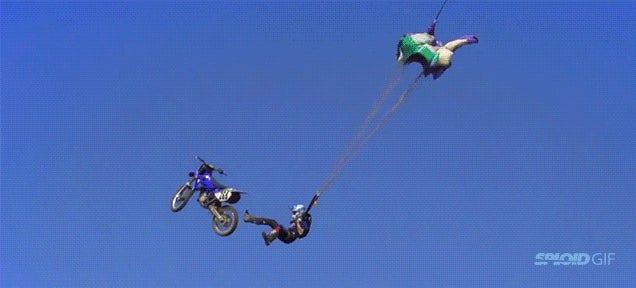 Biker launches from 100-foot ramp, jumps off his bike using a parachute