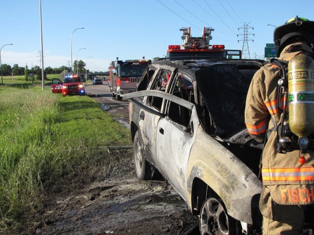 Hero Rips Open Door of Burning Car and Saves Man from Fiery Death