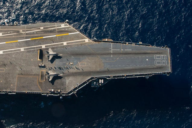 Extraordinaryoverheadphoto of two F-35s on anaircraft carrier