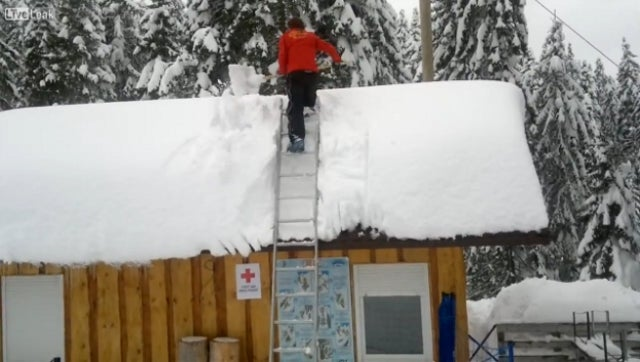Snow Clearing 'Idiot' Falls Off Roof, Makes Once-In-A-Lifetime Save