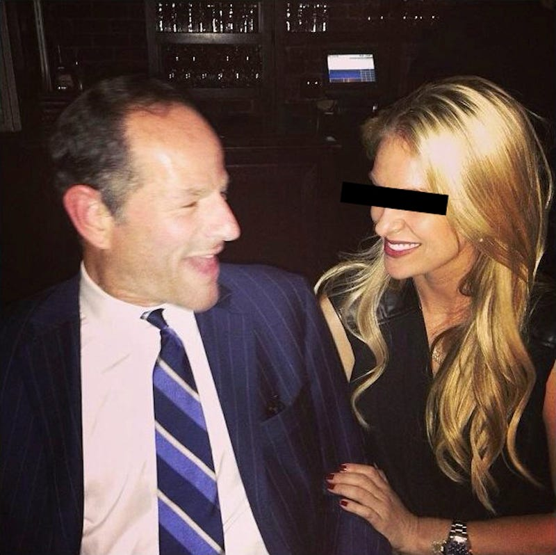 A Cute Photo of Eliot Spitzer Making Friends at an Avicii Party