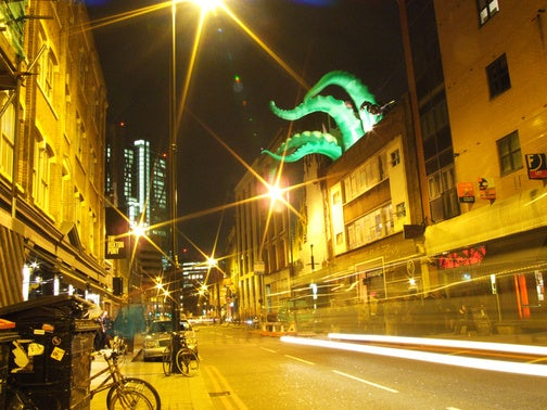 Giant Green Tentacles Attack Buildings from the Inside