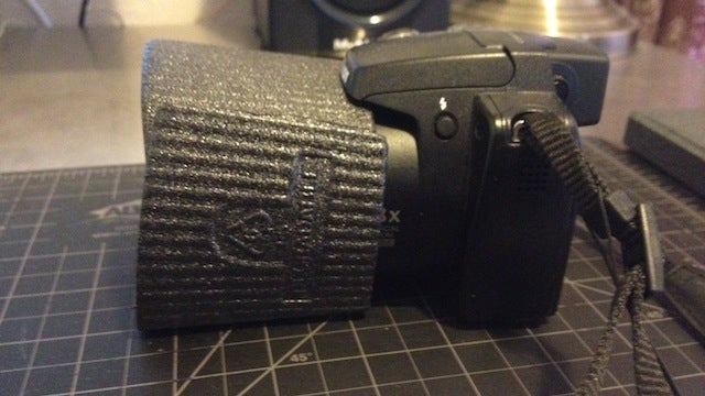 Use a Coffee Sleeve as a Makeshift Lens Hood