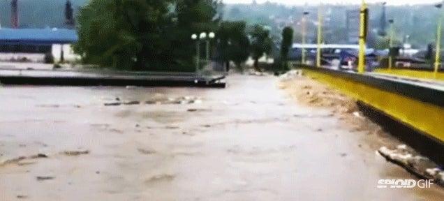 Flood makes bridge collide with another bridge