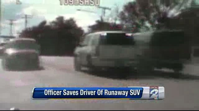Cop stops runaway SUV seconds before disaster