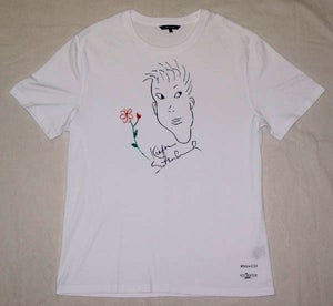 The Trick To World Peace? Give A Star A T-Shirt And A Pen