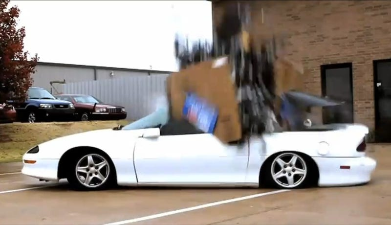 Watch 1,500 Lbs. Of Cell Phones Dumped On A Camaro
