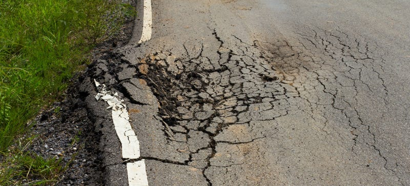Why Potholes Happen (And How to Get Them Fixed)