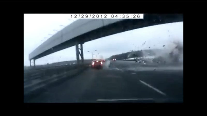 Russian Dash Cam Captures Moscow Plane Crashing Into Highway