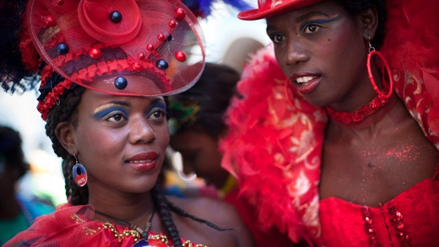 Haitian Women Celebrate With Red Garb, Courage