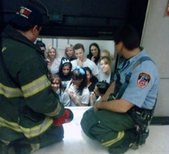 Terror At 92 Feet; Brave Cheerleading Squad Somehow Survives Being Stuck In Elevator
